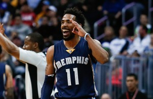 Jan 21, 2016; Denver, CO, USA; Memphis Grizzlies guard Mike Conley (11) reacts after making a three point shot in the final second of the second quarter against the Denver Nuggets at the Pepsi Center. Mandatory Credit: Isaiah J. Downing-USA TODAY Sports